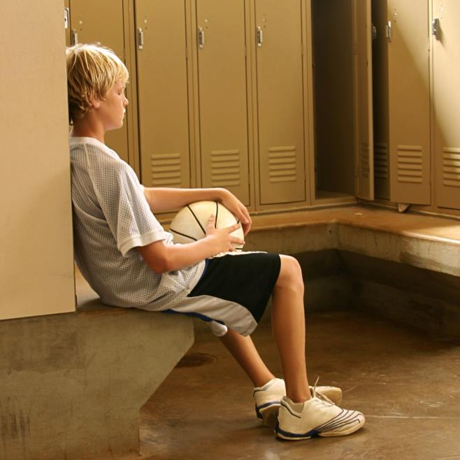 sad-basketball-kid-in-locker-room-cropped.jpg