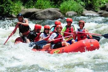 A-group-enjoying-a-white-water-rafting-trip.jpg