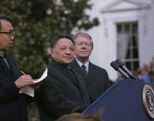 Deng_Xiaoping_and_Jimmy_Carter_at_the_arrival_ceremony_for_the_Vice_Premier_of_China._-_NARA_-_183157-restored.jpg